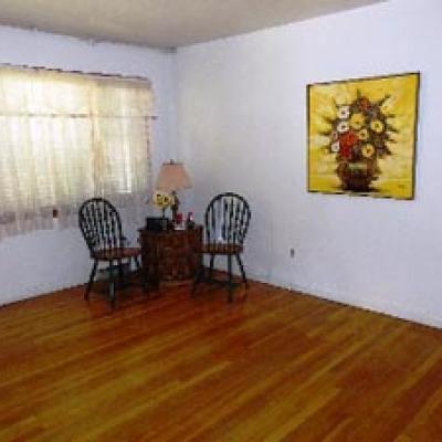 Living Room of Lovely 4-Bedroom Cape in Stapleton for sale in Staten Island New York
